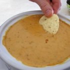 Jeff's Chili Con Queso - This simple cheese and chili dip is great with tortilla chips or French bread. It may be prepared and served in a slow cooker, if desired. A fondue pot also works well for keeping the finished dip warm.