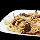 Butter Beef - Easy, melt in your mouth onion-buttery beef from your slow cooker! Serve over cooked egg noodles.