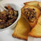 Mediterranean Tapenade - Anchovies and olives are processed with capers, garlic, basil, and capers for a Mediterranean-style dip to serve with crostini.
