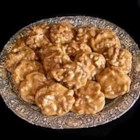 Pecan Pralines - Pecans are cooked in a sugar syrup then dropped by spoonfuls onto baking sheets to set.
