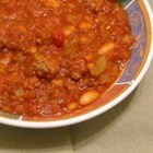 Minnesota Golf Course Chili - Ground beef is simmered with bell pepper, garlic, tomatoes, kidney beans and chili powder in this easy chili.