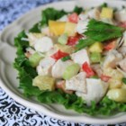 Tropical Turkey Salad - A tropical twist on the Waldorf Salad! Turkey breast and pineapple are tossed with crisp celery, red bell pepper, and green onion, finished with a creamy curried mango dressing.