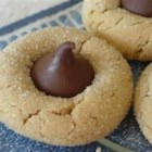 Peanut Blossoms II - Peanut butter cookies are baked for 10 minutes, topped with a chocolate candy kiss, then baked until golden. Great for cookie trays!