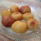 Gulab Jamun - This is a traditional Indian dessert.  Spongy milky balls soaked in rose scented syrup. Delicious with fresh cream, Kulfi, ice cream etc. To make it even more fancy, sprinkle gold-leaf on top of each serving.