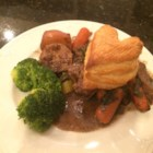 Slow Cooker Guinness(R) Beef Stew - Guinness(R) beef stew loaded with potatoes and plenty of seasoning is simmered in the slow cooker and topped with puff pastry for the perfect comfort food on cold evenings.