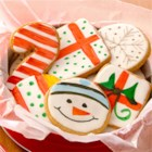 Holiday Painted Cookies - Make a quick and easy glaze for cookies by warming canned white frosting in the microwave. Then paint colorful designs on the cookie shapes using Flavor Paints––a fragrant mix of vanilla or lemon extract and food color.
