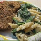 Spinach Casserole - Seashell pasta is baked with spinach and cottage cheese, and topped with a buttery, bread crumb mixture.