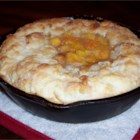Skillet Peach Pie - Peach cobbler made in a skillet. In place of pie crust, try using biscuits.