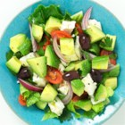 Greek Salad by Avocados From Mexico - Cubes of avocado make a rich addition to this classic Greek salad with kalamata olives, fresh parsley, tomatoes, and feta cheese.