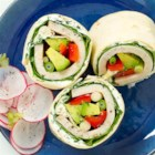 Turkey Wrap by Avocados From Mexico - Cream cheese, bell pepper strips, turkey, lettuce and chunks of avocado are rolled into tortillas spread with cream cheese then sliced into delicious bite-size pieces.