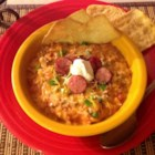 Creamy Spanish Rice Soup - Spanish rice combined with tomato soup, cream cheese, sausage, and peppers make a hearty soup that will please everyone in the family.