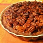 Honey Crunch Pecan Pie - The cooked pecan filling is made with lots of sugar, eggs and corn syrup, and a bit of vanilla and bourbon. It 's poured into a homemade crust, and topped with luscious pecan halves bathed in brown sugar, butter and honey.
