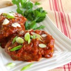 Meatloaf Patties - These delicious, kid-approved mini-meatloaf patties simmered in a tomato sauce are done on the stove top in about half an hour.