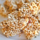Puffed Millet Squares - Puffed millet, peanut butter, and honey are stirred together creating a new twist on puffed cereal treats. Bring to your next party or gathering!