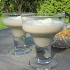 Caramel Creme Cocktail - Vodka, Irish cream liqueur, milk, and club soda are poured over a scoop of vanilla ice cream to make a caramel creme cocktail.