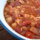 Jill's Vegetable Chili - Cubed turkey meat is simmered with tomatoes, beans and corn and spiced with chili powder, cumin and cinnamon in this quick chili.