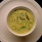 Cream of Asparagus Soup I - Fresh asparagus and potatoes are pureed with chicken stock in this creamy soup seasoned with soy sauce.