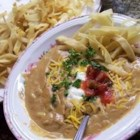 Chicken Enchilada Soup II - This hearty soup won't leave you hungry!  Chicken broth hosts enchilada sauce, processed cheese, onion and garlic for this soup version of a Mexican inspired favorite.  Garnish with shredded cheese and crumbled tortilla chips, if desired.