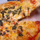 New York Style Pizza - This is a no frills New York Pizza with heaps of mozzarella cheese and fresh basil. Use it as a base and add your favorite pizza toppings if you wish.