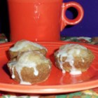 Ginger Apple Cups - Spice cookies baked in mini-muffin tins are filled with an applesauce-cinnamon reduction, then drizzled with a glaze.