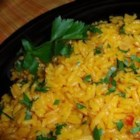 Saffron Rice - Saffron-scented rice cooked with butter and onion makes a wonderful side dish for any special occasion.
