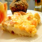 Christmas Morning Egg Casserole - Warm up the kitchen on a holiday morning with a ham, egg, and cheese casserole for a filling and rich breakfast dish.