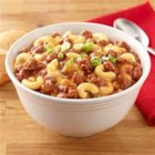 Chili Mac 'n' Cheese Bake - This chili mac 'n' cheese casserole with salsa, green peppers, and chili powder is ready to serve in less than an hour.
