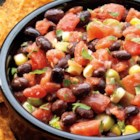 Black Bean and Corn Salsa from RED GOLD(R) - Fresh summer flavors any time of the year! Our tomatoes combined with corn and black beans, green onions and cilantro make the best dip. All you need is a sturdy chip!