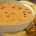 World's Best Queso Dip - You will love our super simple, delicious, 2-ingredient recipe! Why World's Best? Because of our fresh tasting Red Gold Petite Diced Tomatoes & Green Chilies. Add ground beef, chorizo, beans or whatever you please to create your flavor favorites!