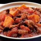 Sausage & Sweet Potato Chili - Chili gets a makeover with Italian sausage, Crushed and Diced Tomatoes, black beans and sweet potatoes. The sweetness of the potato balances the spice in the sausage perfectly! All cooked in your slow cooker, just fifteen minutes of prep in the morning results in a tasty dinner after a long, busy day!