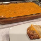 Mexican Lasagna Chip Dip - I'm not sure why it's called lasagna, but it is very good. A beef and refried bean mixture is buried in melted cheeses. Try serving it for a New Years or Super Bowl party.