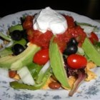Taco Salad - Katherine's Famous Vegetarian Taco Salad; layered, so chips don't get soggy! Top with sour cream or guacamole if you'd like. We like to make our own bowls for individual tastes.