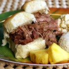Oven Kalua Pork - Fire up the tiki torches -- it's time for a luau! This delicious slow-roasted pork is rubbed with sea salt and liquid smoke to recall the glorious flavors of pig cooked in a traditional Hawaiian imu. Once cooked and cooled, it can be shredded and served with poi, yams or even on a bun. You may use ordinary sea salt for this recipe if the Hawaiian variety is unavailable.