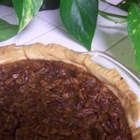 Pecan Pie VI - Nobody can resist a sweet and nutty pecan pie! This pecan pie is made with brown sugar and light corn syrup and is even more delicious when served with whipped cream.