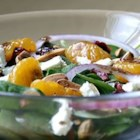 Beautiful Salad - A spur-of-the-moment creation when I wanted something with a great flavor punch and lots of color, plus quick to prepare---this one fills the bill, with  baby spinach and colorful cranberries and mandarin oranges, plus the crunch of sweetened  almonds and the pungent feta cheese---a new favorite at our house! You may substitute blue cheese for the feta and any kind of sweetened pecans or walnuts, if desired, for the almonds.