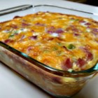 "Wake-Up Casserole - Hash brown potatoes, Cheddar cheese, ham, and eggs are baked together into a breakfast casserole cleverly named ""wake-up casserole""."