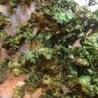 Paleo Kale Chips - These paleo kale chips are coated in coconut oil and garlic salt for a quick and easy snack for kids and adults.