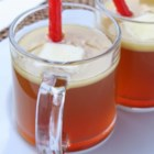 Hot Buttered Rum Punch - Dark rum, brown sugar, pineapple juice, and cranberry sauce are simmered together in a slow cooker creating a delightful hot buttered rum punch.