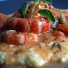 Garlic Cheese Grits with Shrimp - Grits are cooked with garlic flavored processed cheese, and served with sauteed shrimp and tomatoes.