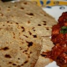 Indian Chapati Bread - A simple but delicious recipe for Indian flatbread. Serve with Indian curry, main dishes, or even use to make sandwich wraps. Enjoy!