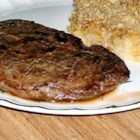 Steak Continental - Scored round steak is marinated with soy sauce and tomato paste seasoned with garlic and oregano, then broiled or barbecued.