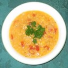 Apricot Lentil Soup - This pureed soup is made with red lentils, dried apricots and tomatoes cooked in chicken broth with cumin and thyme.  The addition of fresh lemon juice prior to serving intensifies the flavors.