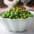 Peas and Pancetta - Peas and pancetta are pan-fried in white wine and thyme creating a flavorful Italian-inspired side dish.
