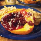 Cranberry Sauce for Acorn Squash - This recipe has been passed around the family for years. A pretty cranberry sauce replaces plain brown sugar as a topping for acorn squash. The squash may be cooked more quickly in the microwave by cooking it on high 5 minutes, cutting it in half, removing the seeds and cooking another 5 minutes, or until tender.