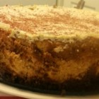 Pumpkin Cheesecake with Sour Cream Topping - Sweet and traditional pumpkin cheesecake with a sour cream topping.