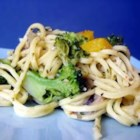 Linguini with Broccoli and Red Peppers - Colorful bits of broccoli and red bell peppers, sauteed in olive oil and garlic, are tossed with fresh linguine and dusted with Parmesan cheese for a quick, delicious entree or side dish.