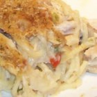 Turkey Tetrazzini I - Angel hair pasta is layered with a creamy turkey mixture and grated cheese in a baking dish in this casserole which also freezes well.