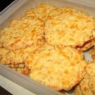 Cheese Crispies - Snap, crackle and pop cereal goes savory here in this hot, cracker-like appetizer made with cheddar, spices and more.