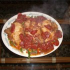 Tender Tomato Chicken Breasts - Seasoned chicken is stewed with tomatoes and served over mixed vegetables. Goes well with rice.