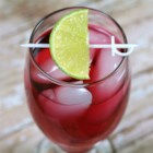 Thanksgiving Refreshment - Keep your Thanksgiving guests hydrated with this refreshing cranberry juice beverage garnished with a lime wedge.